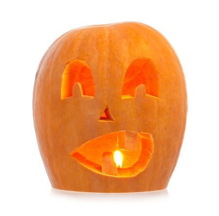 Halloween gourd with the lit candle isolated  photo