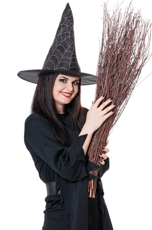 coquette: Young witch coquette with broom isolated on white background Stock Photo