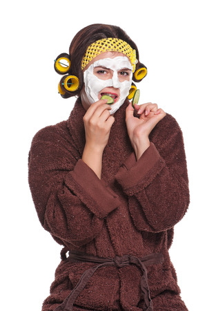 Beautiful young woman with a mask on her face on a white background photo
