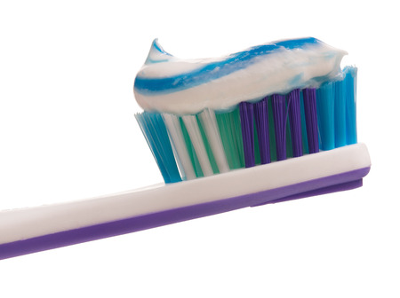 Light-violet toothbrush with toothpaste isolated on white background photo
