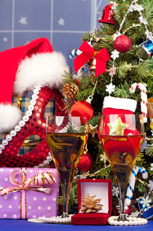 Christmas presents with garland over christmas spruce background photo