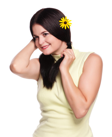 overindulgence: Young pretty girl with camomile in her hair isolated on white background