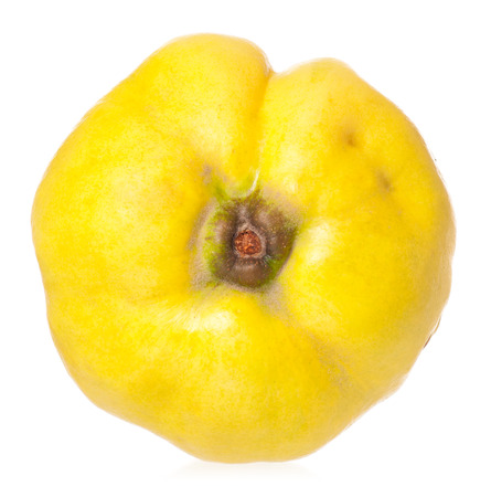 Raw bright yellow quince isolated on a white background photo
