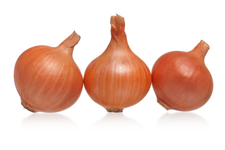 raw gold: Raw gold onions rowed isolated on white background