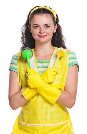 houseclean: Young housewife with crossed brushes isolated on white background Stock Photo