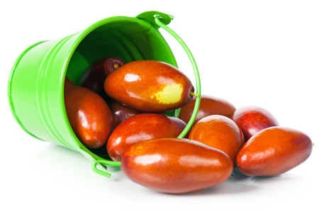 dates fruit: Raw jujube fruit in the garden bucket isolated on white background Stock Photo