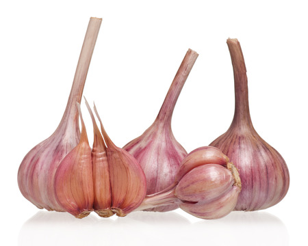 clean artery: Garlic bulbs with cloves isolated on white background cutout