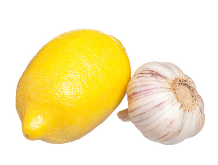 clean artery: Fresh lemon with raw garlic isolated on white background Stock Photo