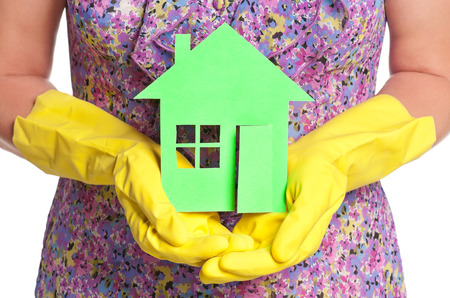 home made: Paper house on woman hands in rubber gloves concept Stock Photo