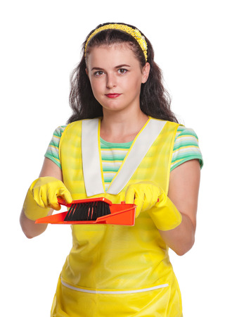 houseclean: Young housewife with scoop and broom isolated on white background