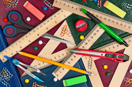 ruler: Wooden rulers with school accessories on a books covers close-up
