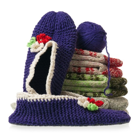 spokes: Pile of knitted socks with spokes and threads over white background