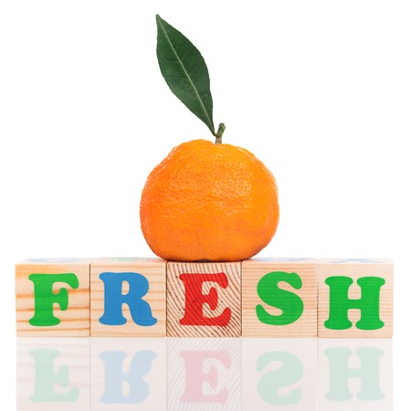 mandarins: Fresh ripe tangerine with playing cubes isolated over white background