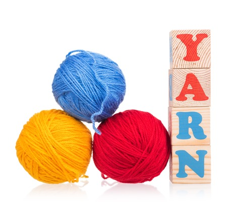 woollen: Bright woolen yard with playing cubes over white background