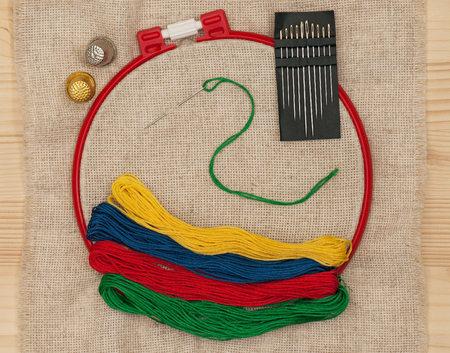 darn: Bright embroidery accessories with sewing needles over outline background