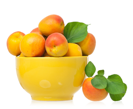 bawl: Ripe apricots in a bawl isolated on a white background Stock Photo
