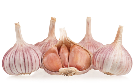 Raw garlic bulbs isolated on white background Stock Photo