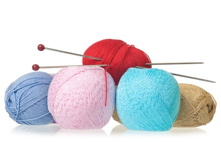 Colorful threads with knitting accessories isolated on white background Stock Photo