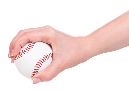 Young female hand holding baseball ball isolated over white background