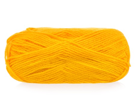 Yellow woolen yarn for knitting isolated on white background Stock Photo