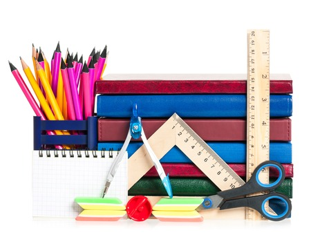 School exercise-book with accessories isolated on white background