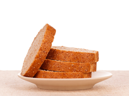 bran: Fresh bread with bran on a plate over white background