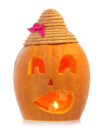 Scary Halloween gourd with the lit candle isolated on white background