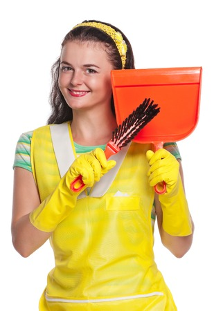 houseclean: Young housewife with yellow rubber gloves isolated on white background