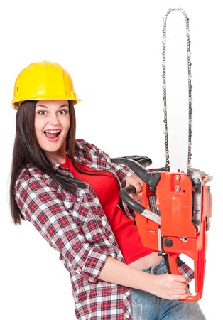 Crazy young woman with gasoline-powered chainsaw isolated on white background Stock Photo