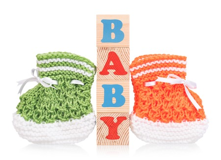 woollen: Cute little bootee with toy cubes isolated over white background