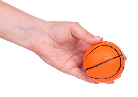 Small basketball toy ball in female hand over white background Stock Photo