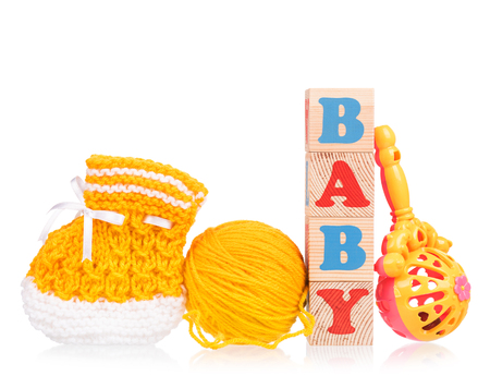 hank: Cute little bootee with toy cubes isolated over white background