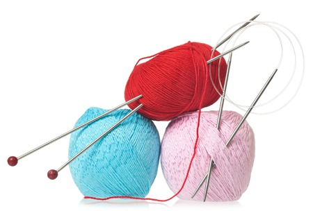 spokes: Bright woolen threads with spokes for knitting isolated on white background