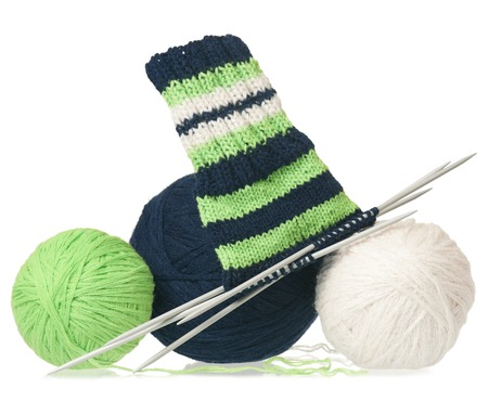 incomplete: Woolen thread with incomplete socks isolated on white background