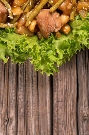 Tasty beef Stroganoff with rice and vegetables over wooden surface with empty space for text Stock Photo