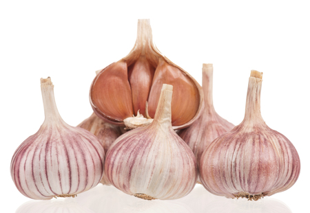Raw garlic bulbs with cloves isolated on white background