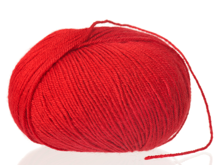 Bright red woolen yarn for knitting isolated on white background
