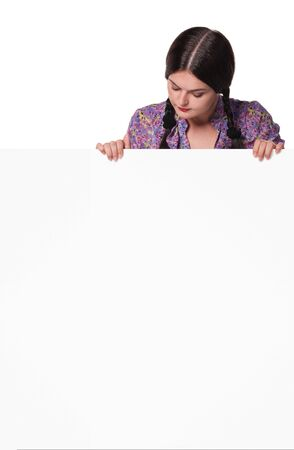 Portrait of a beautiful young woman with blank billboard on white background Stock fotó