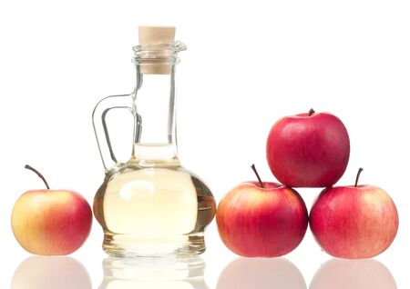 Apple vinegar in the glass bottle with fresh apples isolated over white background Imagens