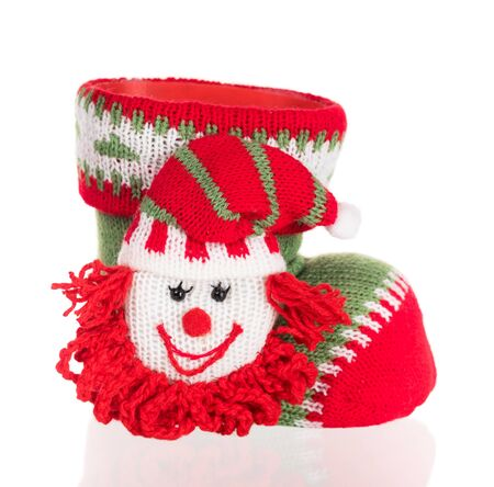 Bright knitting shoe with elf heaf for Christmas eve isolated over white background Reklamní fotografie