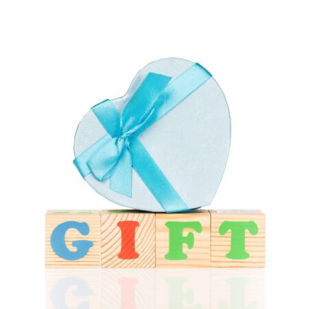 Bright gift box with new playing cubes isolated over white background