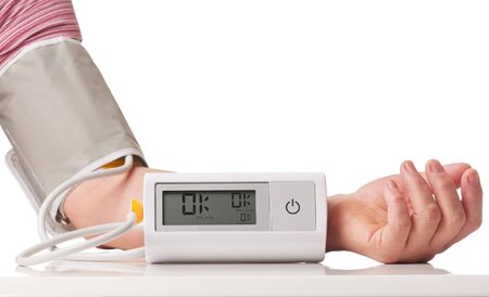 Electronic pressure measuring instrument on the female hand isolated over white background Reklamní fotografie