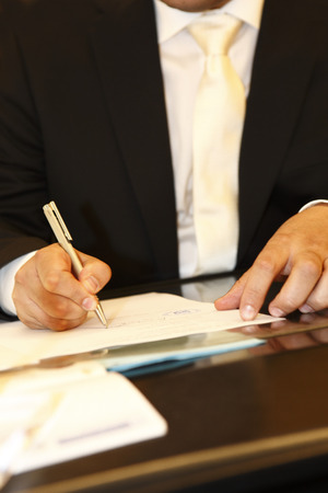 Groom signs the marriage contract photo