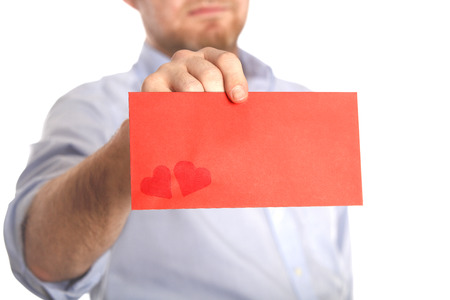 denunciation: Man holds a red love letter