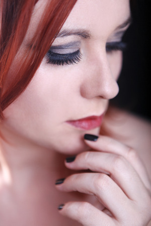 red head woman: Young red head woman with black nails  Stock Photo