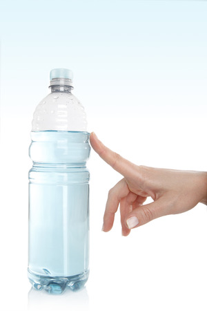 Female hand opens the water bottle photo