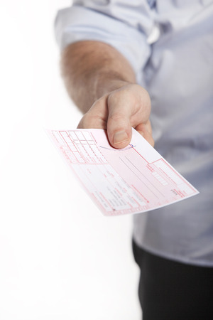prescribe: Man in blue shirt holds doctor prescription in hand Stock Photo
