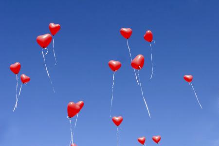 Balloon hearts in the sky photo