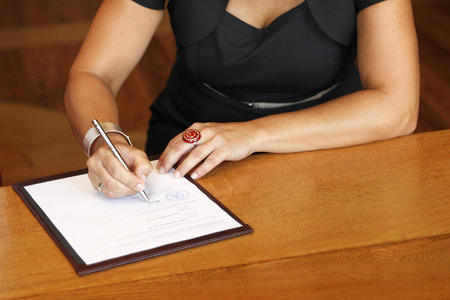 Bride signs the marriage contract Stock Photo - 27918027