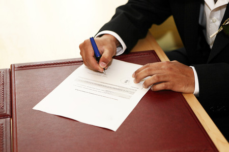 Groom signs the marriage contract Stock Photo - 27918028